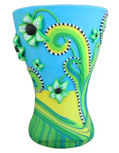 This Graphic inspired vase has flowers that protrude off the surface